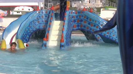 Child having fun at water park