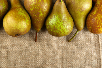 Ripe pears on sackcloth background