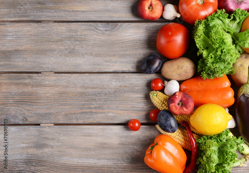 Fotobehang Keuken Fresh organic fruits and vegetables on wooden background