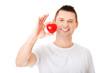 Obrazy na płótnie, fototapety, zdjęcia, fotoobrazy drukowane : Young man holding a red heart