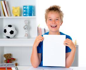 happy boy showing a white sheet