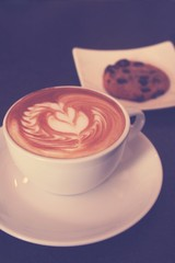 Latte or cappuccino coffee with cookie
