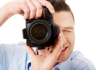 Man photographer with DSLR