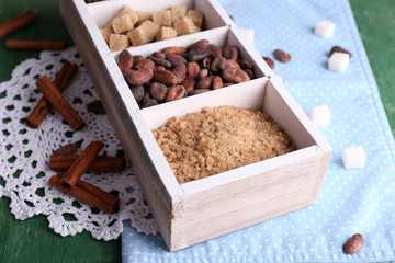 Wooden box with set of coffee and cocoa beans, sugar cubes