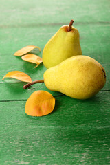 Ripe tasty pears on wooden table