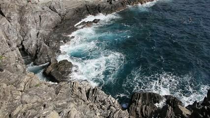 Big waves crashing on the rocks in Manorola, Cinque Terre, Italy