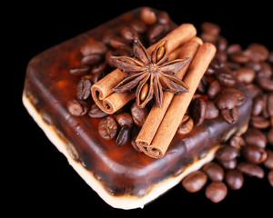 Organic soap with coffee beans and spices, on dark background