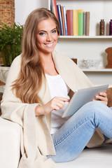 Beautiful young woman holding an ipad