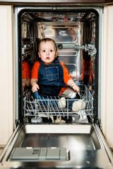Baby hiding in dishwasher