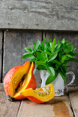 Pumpkin and mint on a wooden table