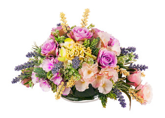 Bouquet from artificial flowers arrangement centerpiece in vase.