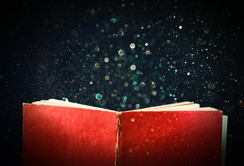 open red book and glowing glittering lights