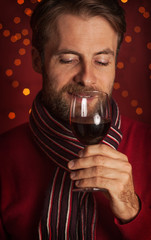 Christmas - portrait of man tasting or drinking wine