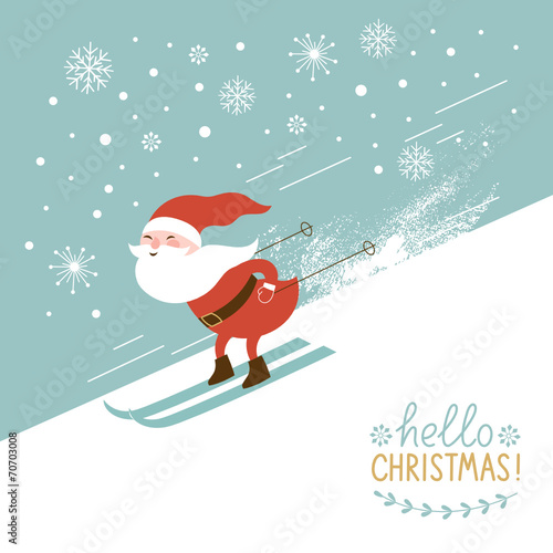 Santa skiing down a mountain slope - 70703008
