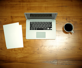 laptop on wooden desk