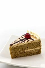 Coffee cake slice on white background.