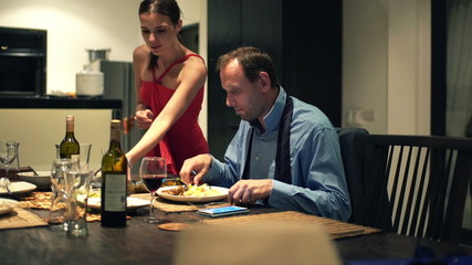 Businessman gets dinner from his wife at home
