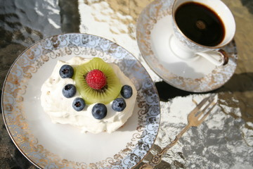 A nice cup of coffee with a piece of gateau