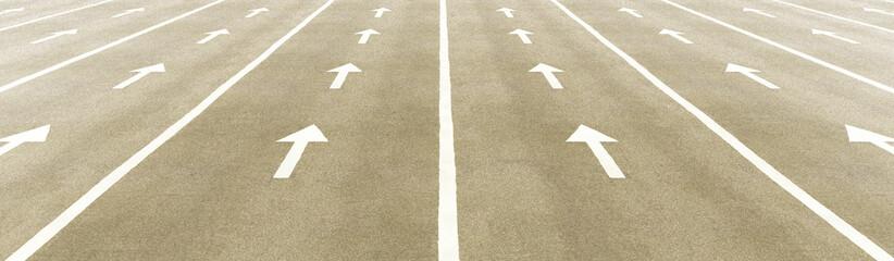 Road arrows into light