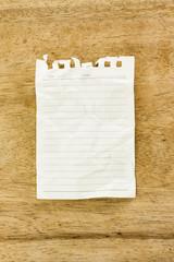 Blank notepad on wooden desk