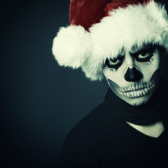 Holiday background of halloween person with terrible skull make-