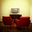 Vintage room with two old fashioned armchairs and retro tvover o - 70705811