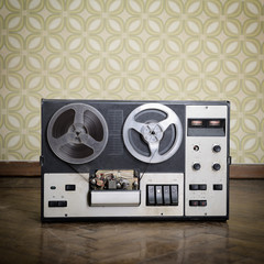 Old portable reel to reel tube tape-recorder, with copyspace. To
