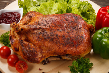 Roast duck on cutting board