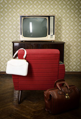 Vintage room with wallpaper, old fashioned armchair, retro tv an