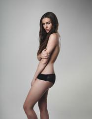 Topless woman wearing black underwear
