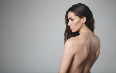Naked female model on grey background