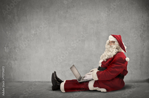 canvas print picture Santa Claus uses technology