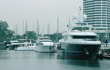 berth with modern large yachts