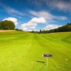 Empty golf fairway in sunny day