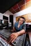 Sound technician in recording studio poster