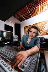 Sound technician in recording studio