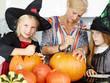Family prepare pumpkins in the kitchen