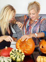 Mothers prepare pumpkins in the kitchen