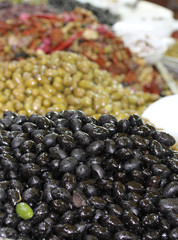green olives of various kinds for sale at the market of southern