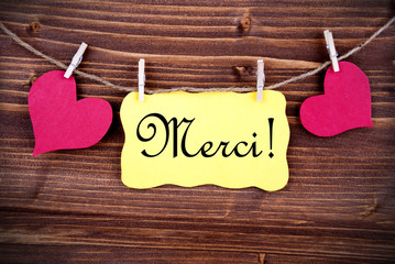 Merci on a Tag Framed By Hearts