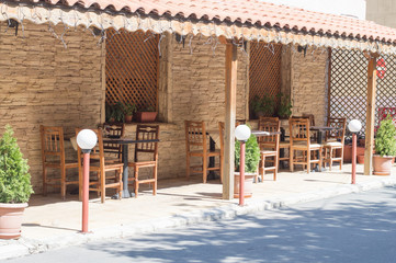 Street cafe terrace with tables and chairs