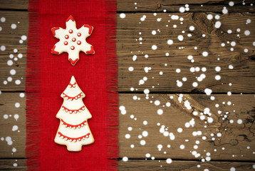 Cookies on Snowy Wooden Background