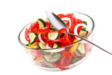 Fresh vegetable salad in a glass dish.
