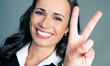 Businesswoman with two fingers or victory gesture