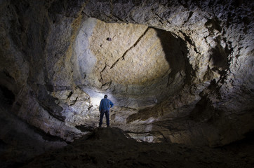 man in a huge cave