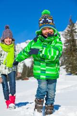 Happy kids playing winter