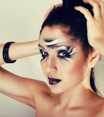beauty young woman with creative make up like zebra