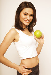 young girl with green apple in studio