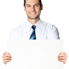Businessman showing signboard, isolated