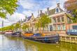 Leinwanddruck Bild - boats in a canal in Harlingen
